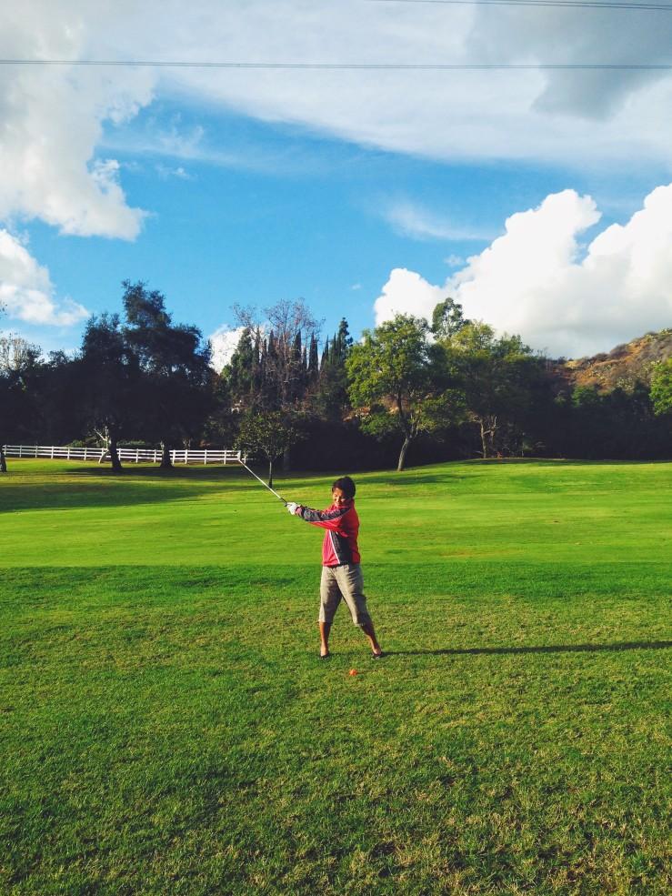 Mom playing golf