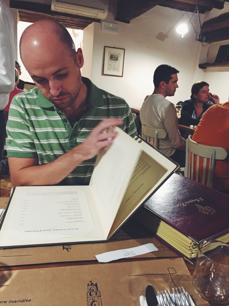 Tom peruses the menu at Il Grappola Blu.